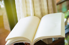 Open book on glass table Stock Image