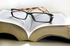 Open book with glasses Royalty Free Stock Photo