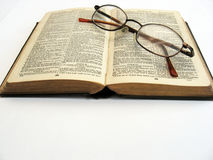 Open book and glasses Stock Photos