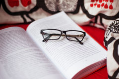 Open book and glasses Stock Image