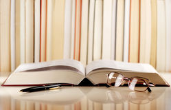 Open book and glasses / library concept Stock Photography