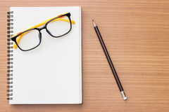 Open book ,glasses and pencil on wood background. Royalty Free Stock Photos