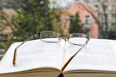Open book and glasses Royalty Free Stock Photos