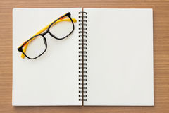 Open book and glasses  on wood background. Royalty Free Stock Photography