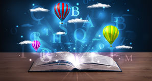 Open book with glowing fantasy abstract clouds and balloons Royalty Free Stock Photography