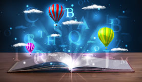 Open book with glowing fantasy abstract clouds and balloons Royalty Free Stock Images