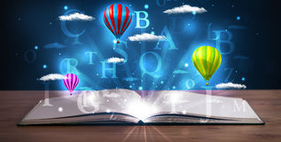 Open book with glowing fantasy abstract clouds and balloons Stock Image