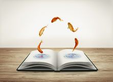 Open book with goldfish Royalty Free Stock Photo