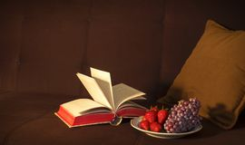 Open Book Beside Grape Fruit and Strawberry Royalty Free Stock Image