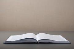 Open book on a gray table closeup Stock Photo