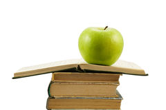 Open book with green apple Royalty Free Stock Photography