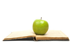 Open Book and green apple Stock Photos