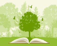 Open book with green tree. And birds. Ecology concept Stock Image