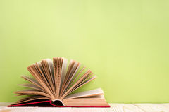 Open book on green wooden background. Education background. Royalty Free Stock Photos
