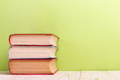 Open book on green wooden background. Education concept. Copy space for ad Royalty Free Stock Photography