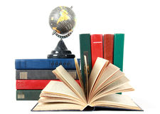 Open book and grey globe Royalty Free Stock Image