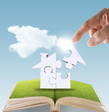 Open book of hand complete puzzle home Royalty Free Stock Photo