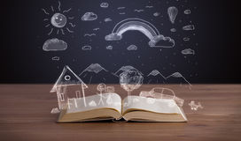 Open book with hand drawn landscape Royalty Free Stock Photos