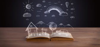 Open book with hand drawn landscape Stock Images