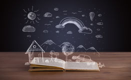 Open book with hand drawn landscape Stock Image