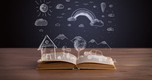 Open book with hand drawn landscape Royalty Free Stock Images