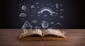 Open book with hand drawn landscape Stock Photography