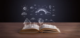 Open book with hand drawn landscape Royalty Free Stock Photo