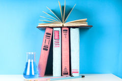 Open book, hardback books on bright colorful background. Stock Photos