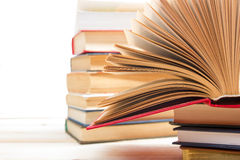 Open book, hardback books on wooden background. Back to school. Copy space.  Stock Photo