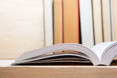 Open book, hardback books on wooden background. Back to school. Copy space.  Stock Photos
