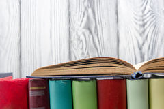 Open book, hardback books on wooden background. Back to school. Copy space Stock Photos