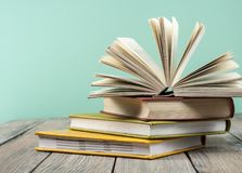 Open book, hardback books on wooden table. Education background. Back to school. Copy space for text. royalty free stock image