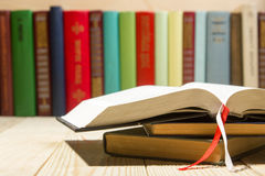 Open book, hardback books on wooden table. Back to school. Copy space Stock Image