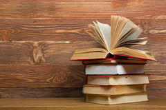 Open book, hardback books on wooden table. Back to Royalty Free Stock Photography