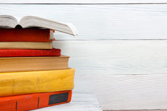 Open book, hardback books on wooden table. Back to Stock Image