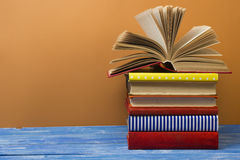 Open book, hardback books on wooden table. Back to school. Copy space for text Stock Photo