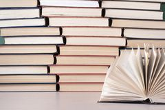 Open book, hardback books on wooden table. Education background. Back to school. Copy space for text. stock images