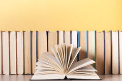 Open book, hardback books on wooden table. Education background. Back to school. Copy space for text. Stock Image