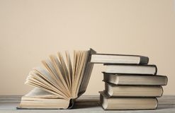 Open book, hardback books on wooden table and colorful wall .Education background. Back to school. Copy space for text. stock photos
