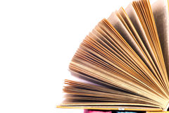 Open book, hardback bookson bright colorful background. Royalty Free Stock Photo