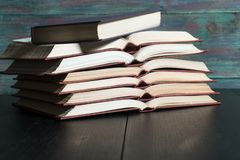 Open book hardback on Stack books. On wooden background. Back to school with copy space royalty free stock photos