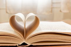 open book with heart Stock Photo