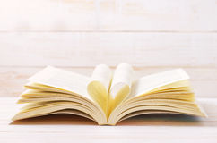 Open Book with heart shape in the middle page Royalty Free Stock Image