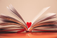 Open book with heart. Valentine's open book with small heart closeup Royalty Free Stock Photo