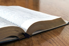 Open book Holy Bible on yellow wooden background Stock Photography