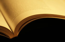 Open book. Horizontal photo of an old open book on black background Stock Image