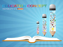 Open book idea and pencils.education concept.can be used for lay Stock Images