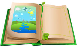 Open book with an illustration of the landscape. Royalty Free Stock Image