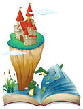 An open book with an image of a castle in an island stock illustration
