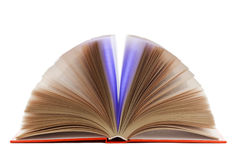 Open book isolated. Knowledge shining from magic open book isolated Royalty Free Stock Images